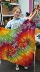 Make a Tie Dye apron perfect gift for the chef in your family! Call today, Limited stock. Only available til December.